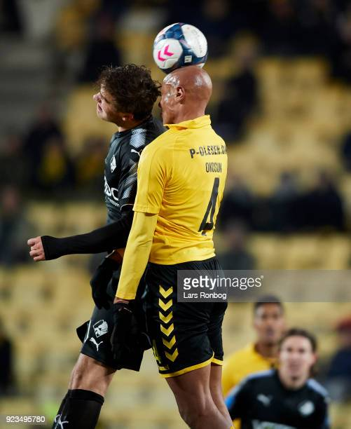 Eero Markkanen of Randers FC and Simon Okosun of AC Horsens compete for the ball during the Danish Alka Superliga match between AC Horsens and...
