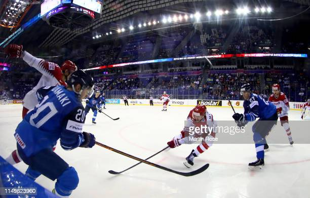 Eetu Luostarinen of Finland challenges Morten Madsen of Denmark during the 2019 IIHF Ice Hockey World Championship Slovakia group A game between...