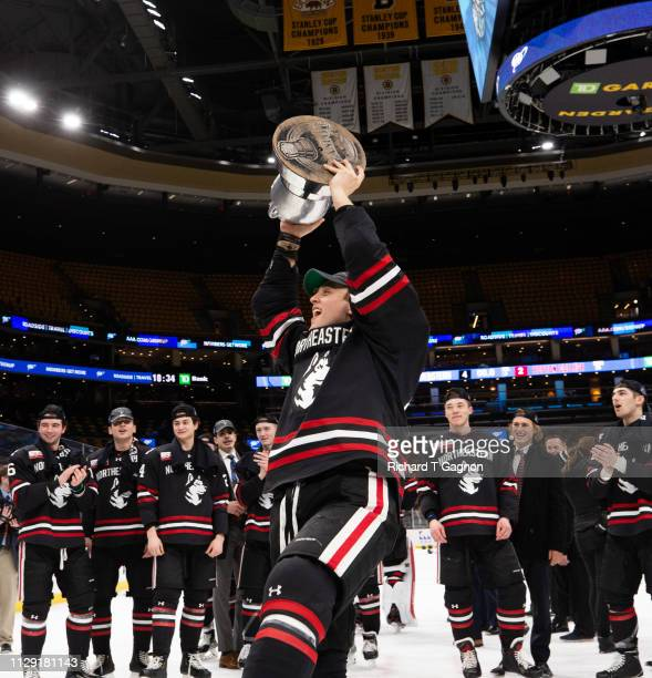 Eetu Selanne of the Northeastern Huskies celebrates with the Beanpot trophy after a victory against the Boston College Eagles during NCAA hockey in...