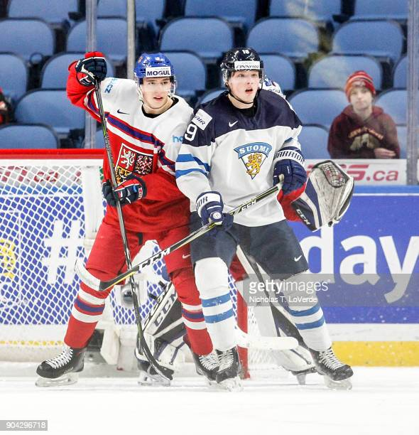 Eetu Tuulola of Finland battles for position with Libor Hájek of Czech Republic in front of the Czech Republic net during the first period of play in...
