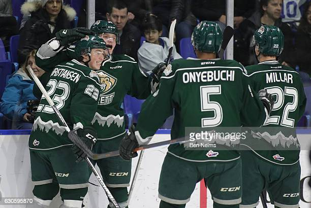 Eetu Tuulola of the Everett Silvertips celebrates his goal against the Vancouver Giants with teammates Jake Christiansen Montana Onyebuchi and Graham...