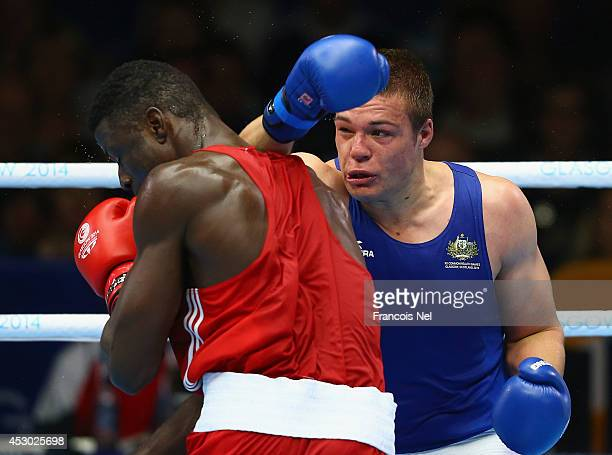 Efe Ajagba of Nigeria competes with Joseph Goodall of Australia during the Men's Super heavy 91 kg SemiFinals Boxing at Scottish Exhibition And...