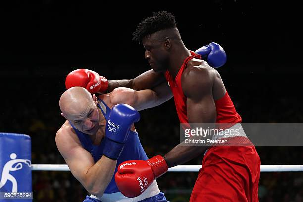 Efe Ajagba of Nigeria fights against Ivan Dychko of Kazakhstan during the Men's Super Heavy Quarterfinal 4 on Day 11 of the Rio 2016 Olympic Games at...