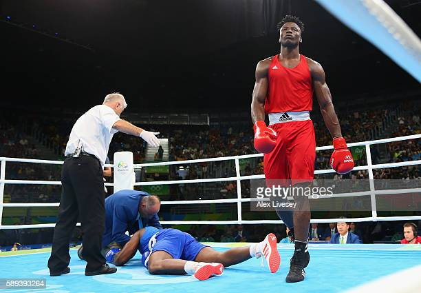 Efe Ajagba of Nigeria knocks out Nigel Paul of Trinidad and Tobago in the Men's Super Heavyweight preliminaries on Day 8 of the 2016 Rio Olympics at...