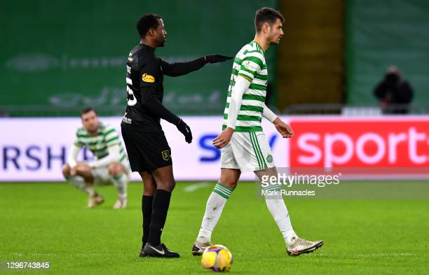 Efe Ambrose of Livingston FC and Nir Bitton of Celtic FC interact following the Ladbrokes Scottish Premiership match between Celtic and Livingston at...