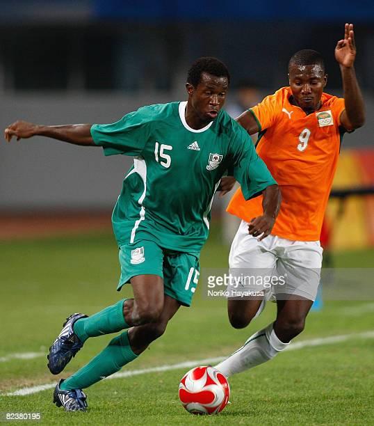 Efe Ambrose of Nigeria and Franck Dja Djedje of Ivory Coast compete for the ball during the Men's Quarter Final match between Nigeria and Ivory Coast...