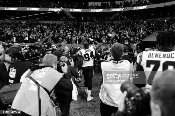 Efe Obada of Carolina Panthers acknowledges the fans as he walks off the pitch at fulltime after his team's victory in the NFL match between the...