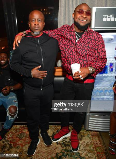 Efe Ogbeni and Davido pose during Ecool Friends Birthday Celebration Concert at Loft on March 22 2019 in Atlanta Georgia