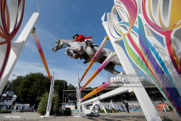 Efe Siyahi of Turkey riding Call Me Princess competes during Day 3 of the Longines FEI Jumping European Championship, speed competition against the...