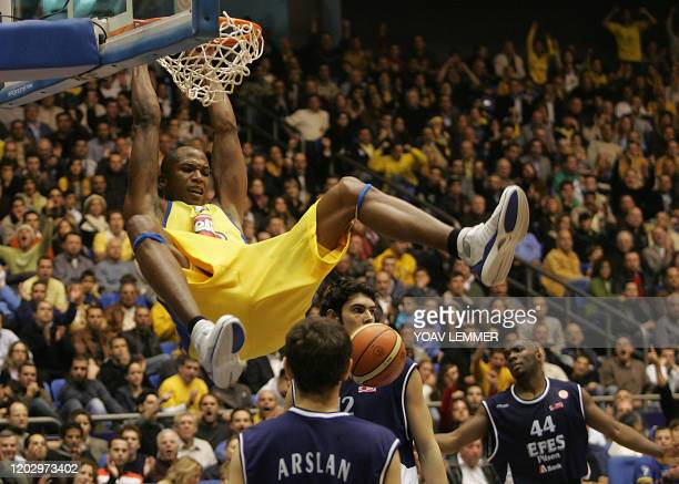 Efes Pilsen's players give up 19 January 2006 as Maccabi Tel Aviv's Baston Maceo finishes his dunk during their Euroleague Basketball match at the...