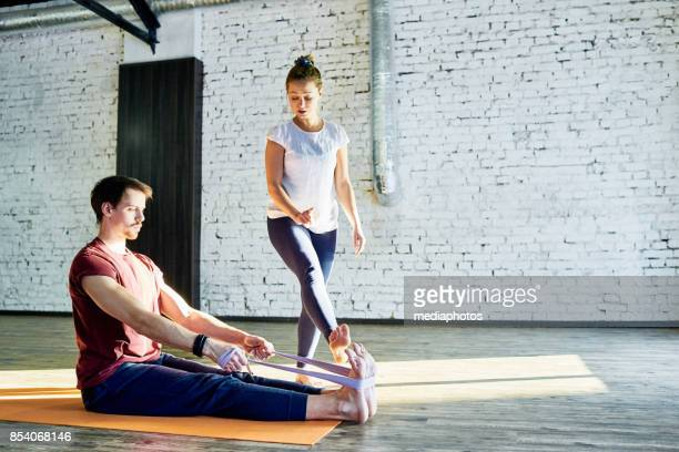 effective yoga training with instructor - strap stock pictures, royalty-free photos & images