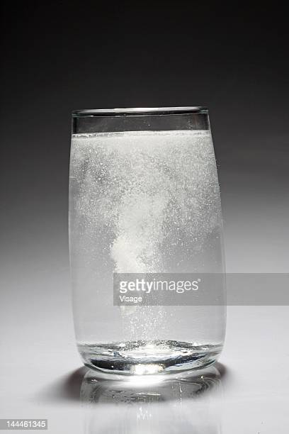 Effervescent tablet dissolving in a glass of water