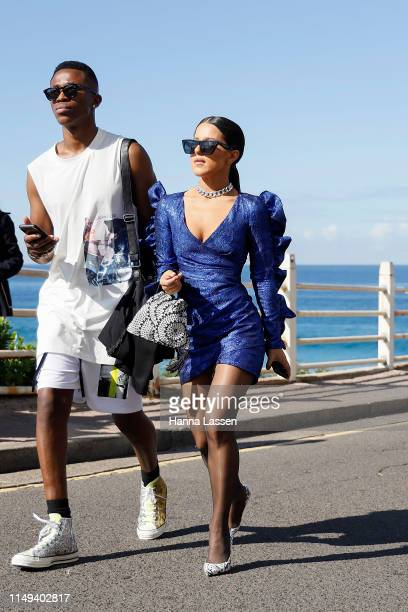 Effie Kats wearing Celeine sunglasses and blue mini dress at MercedesBenz Fashion Week Resort 20 Collections on May 16 2019 in Sydney Australia