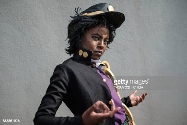 Effie Wambui wearing a costume of character Jotaro Kujo from Japanese manga JoJo's Bizarre Adventure poses after attending the cosplay contest at...