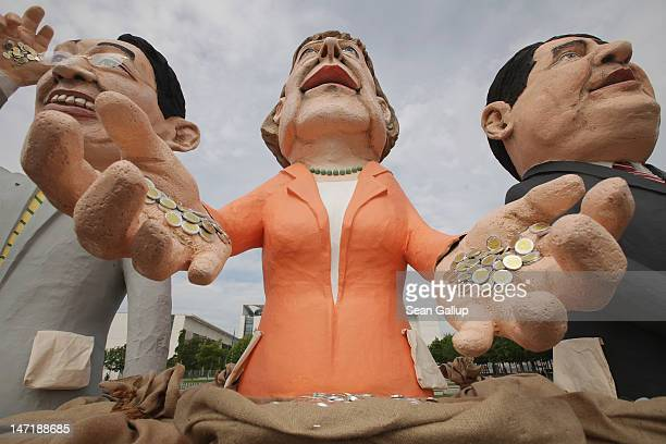 Effigies in the likeness of German Vice Chancellor and Economy Minister Philipp Roesler, German Chancellor Angela Merkel and German Social Democrats...