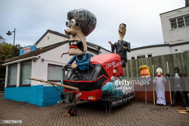 Effigies including one featuring British Prime Minister Theresa May and Jacob ReesMogg sit near the parade route ahead of Bonfire Night celebrations...
