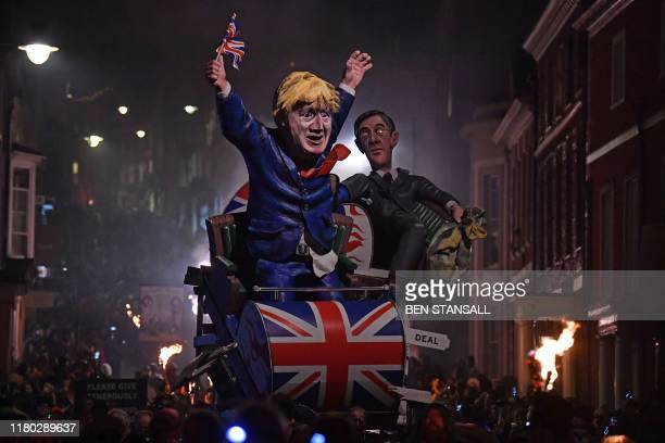 Effigies of Britain's Leader of the House of Commons Jacob Rees-Mogg and Britain's Prime Minister Boris Johnson are paraded through the streets of...