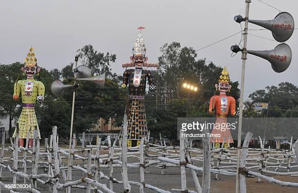 Effigies of demon king Ravana and his son Meghnath and brother Kumbhkaran installed ahead of Dussehra festival at Bittan market on October 2 2014 in...
