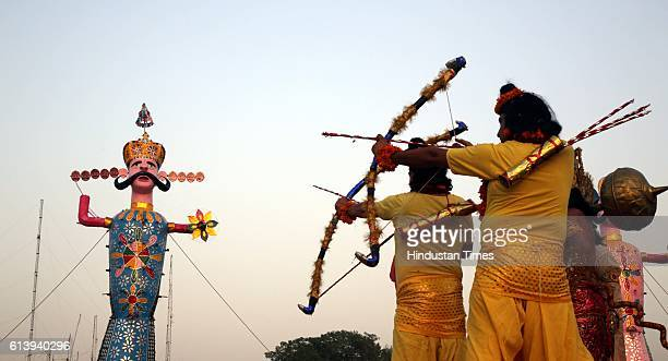 Effigies of demon Ravana being set on fire by Lord Rama during the Dusshera celebrations on October 11 2016 in Jammu India Ramleela is a dramatic...