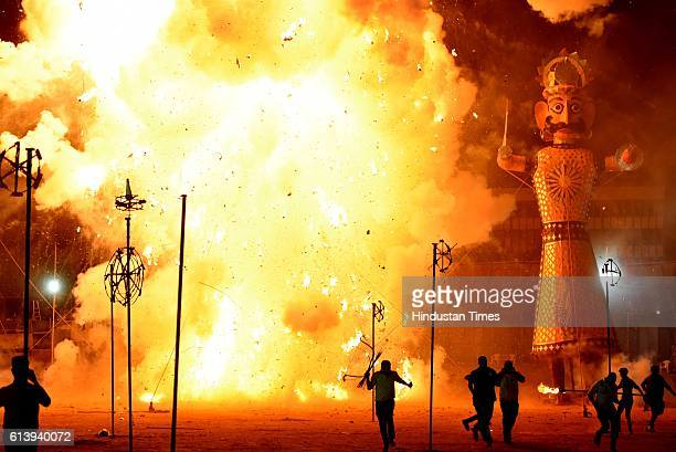 Effigies of demon Ravana Kumbhkaran and Meghnath being set on fire by Lord Rama during the Dusshera celebrations at Ramila Ground on October 11 2016...
