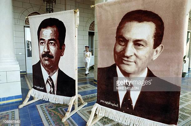 Effigies of Egyptian President Hosni Mubarak and Iraqi President Saddam Hussein are exposed on June 15 1989 during the opening of the Arab...