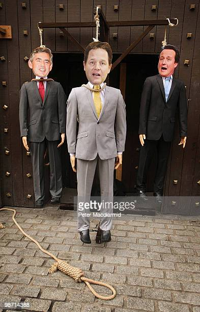 Effigies of party leaders Gordon Brown Nick Clegg and David Cameron are displayed hanging on a gallows outside the London Dungeon attraction on April...