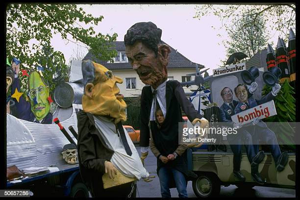 Effigies of Pres Ronald Reagan German Chancellor Helmut Kohl during antinukes antiUS demo coinciding w economic summit Reagan's trip to country