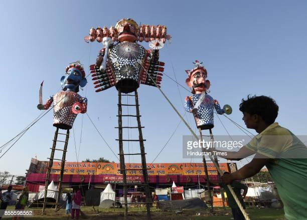 Effigies of Ravana Meghnad and Kumbhakarna being erected a day before Dussehra at Shree Dharmic Leela Committee near Red Fort on September 29 2017 in...