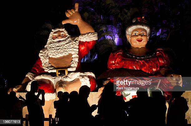 Effigies of Santa and Mrs Claus are seen by visitors at the annual Honolulu City Lights a holiday season tradition at the Honolulu City Hall grounds...