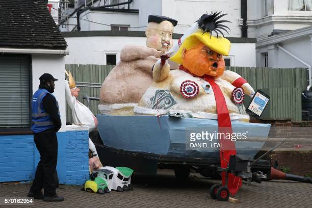 Effigies of US President Donald Trump and North Korean leader Kim JongUn are parked on a sidestreet before being paraded through the streets of Lewes...