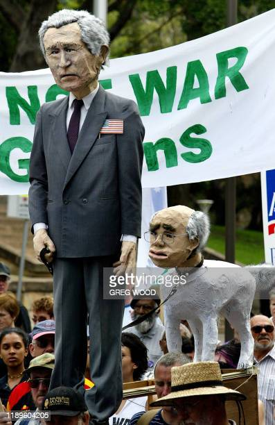Effigies of US President George W Bush and Australian Prime Minister John Howard as a dog form part of the 10000 strong Palm Sunday Rally for Peace...