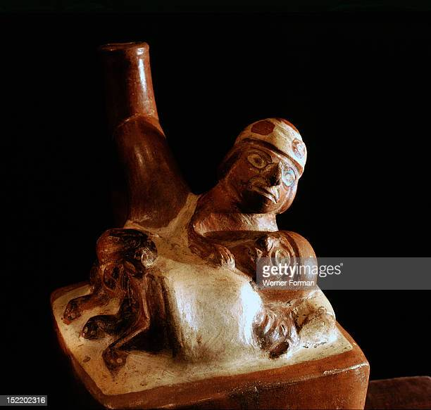 Effigy jar depicting a man and woman covered by a sheet having sexual intercourse in a bed The pose suggests that it may be intended to portray anal...