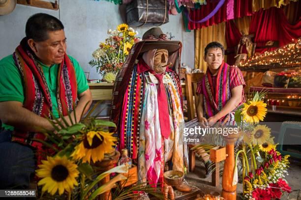 Effigy of Maximon / San Simon, Mayan deity and folk saint in the town Santiago Atitlan at Lago de Atitlan / Lake Atitlan, Solola Department,...