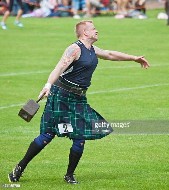 Effort shown by heavy athlete: 56lb weight competition; Highland Games