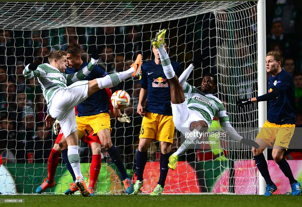 Efi Ambrose and Kris Commons of Celtic go for the same ball during the UEFA Europa League group D match between Celtic FC and FC Salzburg at Celtic Park on November 27, 2014 in Glasgow Scotland.