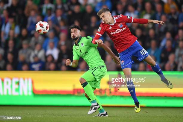 Efkan Bekiroglu of 1860 Muenchen and Lucas Hufnagel of Unterhaching compete for the ball during the 3 Liga match between SpVgg Unterhaching and TSV...