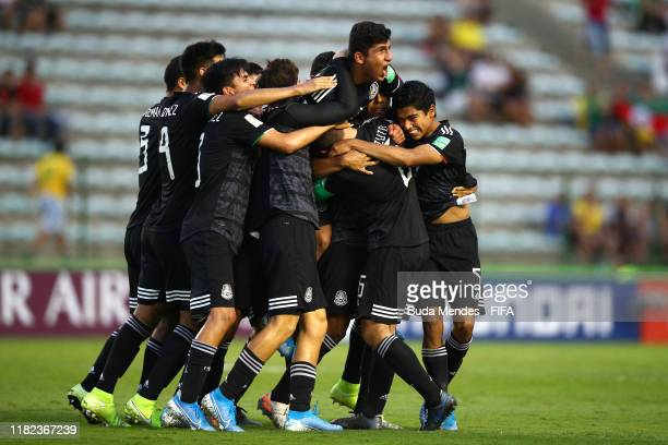 Efrain Alvarez of Mexico celebrates scoring an equalising goal with his team-mates during the FIFA U-17 World Cup Brazil 2019 semi-final match...