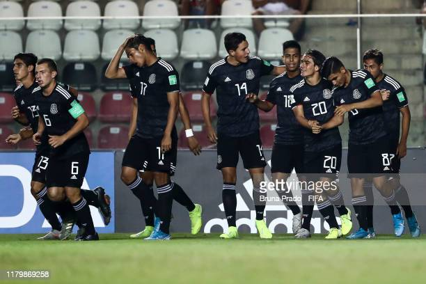 Efrain Alvarez of Mexico celebrates with teammates after scoring a goal during the FIFA U-17 Men's World Cup Brazil 2019 group F match Spain and...