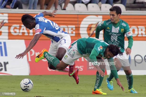 Efrain Cortes of Pachuca vies for the ball with Carlos Pena and Rafael Marquez of Pachuca during their Apertura 2013 tournament of the Mexican League...