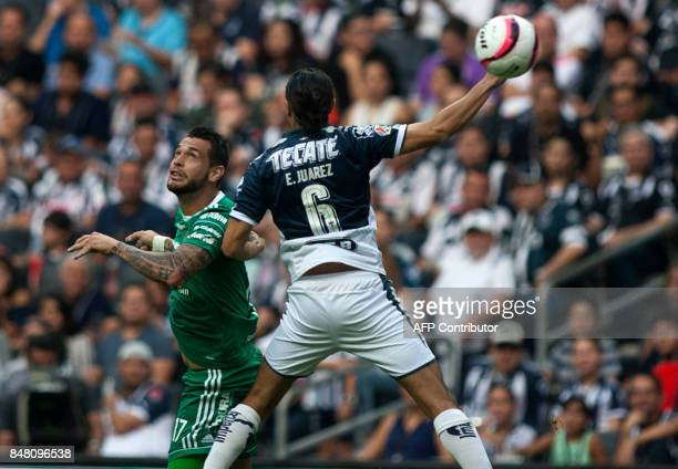 Efrain Juarez of Monterrey vies for the ball with Milton Caraglio of Atlas during their Mexican Apertura 2017 tournament football match at the BBVA...