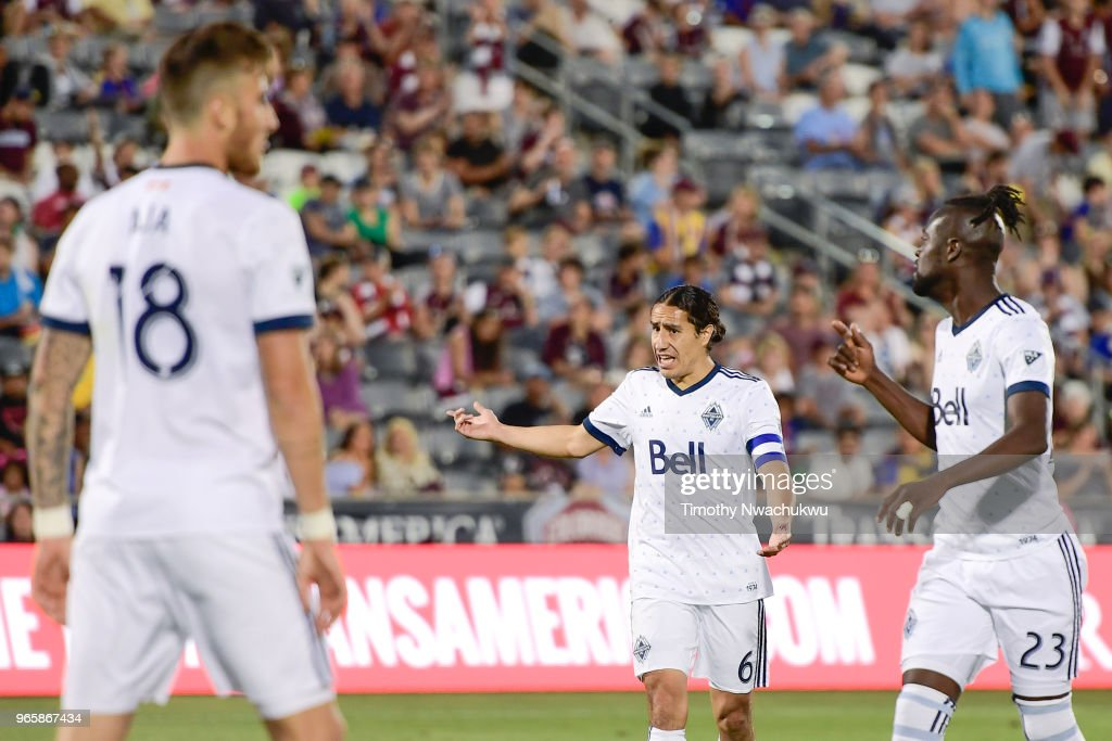 Efrain Juarez #6 of Vancouver Whitecaps, center, calls directions to teammates at Dick's Sporting Goods Park on June 1, 2018 in Commerce City, Colorado.