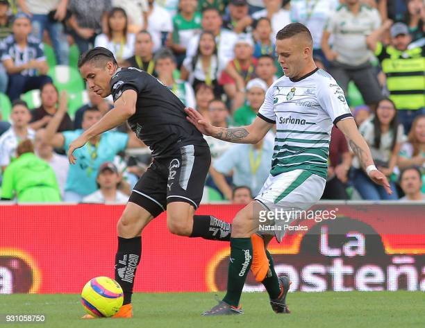 Efrain Velarde of Monterrey and Jonathan Rodriguez of Santos fight for the ball during the 11th round match between Santos Laguna and Monterrey as...