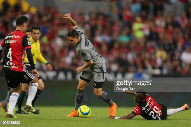 Efrain Velarde of Monterrey fights for the ball with Clifford Aboagye of Atlas during the 9th round match between Atlas and Monterrey as part of the...