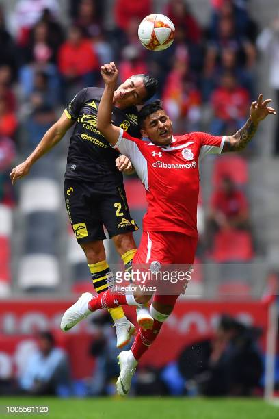 Efrain Velarde of Morelia struggles for the ball with Ernesto Vega of Toluca during the 1st round match between Toluca and Morelia as part of the...