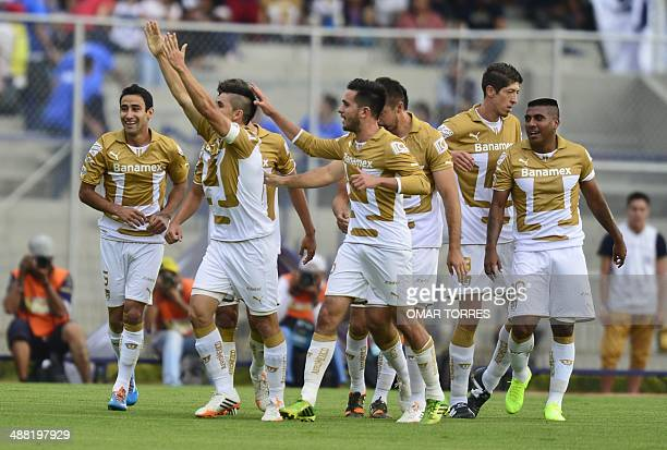 Efrain Velarde of Pumas celebrates a goal against Pachuca with teammates during their Mexican Clausura tournament quarterfinal football match on May...