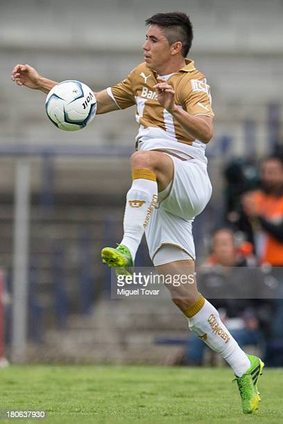 Efrain Velarde of Pumas drives the ball during a match between Pumas and Morelia as part of the Apertura 2013 Liga MX at Olympic stadium on September...