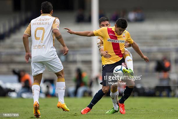 Efrain Velarde of Pumas fights for the ball with Edgar Andrade of Morelia during a match between Pumas and Morelia as part of as part of the Apertura...
