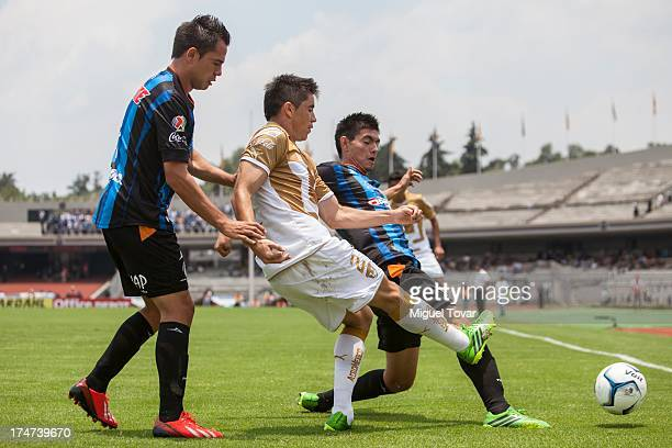 Efrain Velarde of Pumas fights for the ball with George Corral of Queretaro during a match between Pumas and Queretaro as part of the Apertura 2013...