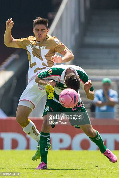 Efrain Velarde of Pumas fights for the ball with Oribe Peralta of Santos during a match between Pumas and Santos as part of the Apertura 2013 Liga MX...