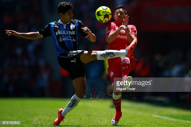 Efrain Velarde of Toluca fights for the ball with Jaime Gomez of Queretaro during the 16th round match between Toluca and Queretaro as part of the...